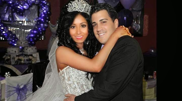 Nicole Polizzi with her fiance Jionni LaValle photo