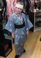 Boy wearing a Yukata with Japanese headband from Kimono House NY