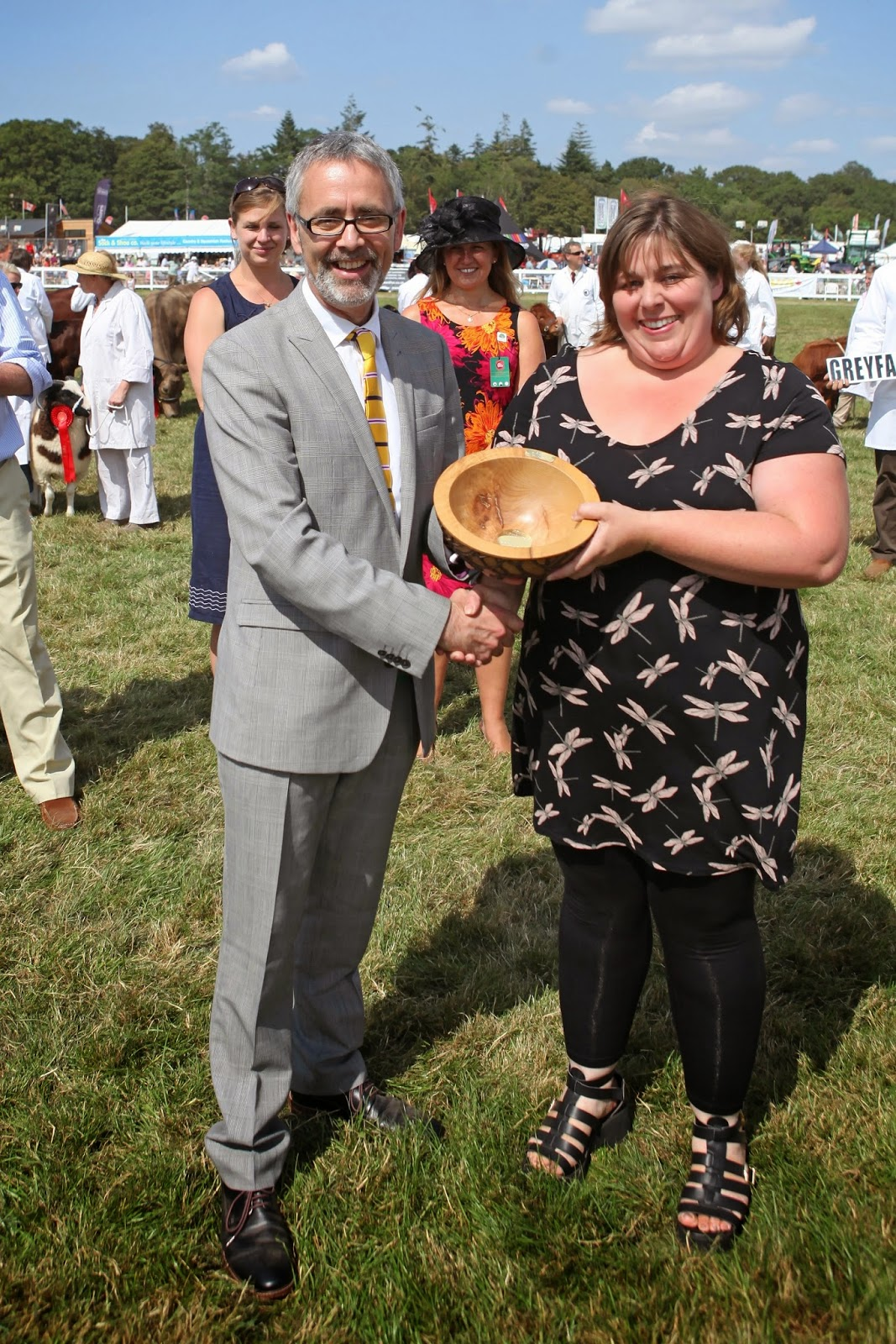 Catherine Shutler of Cyril's Soap Shed collects her Best Supporter of Local Produce award from VisitEngland Chief Executive James Berresford.