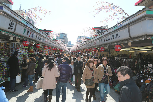 You will find  typical Japanese souvenirs and snacks along the shopping street of Nakamise after passing the outer gate of Asakusa Sensoji Temple in Tokyo, Japan