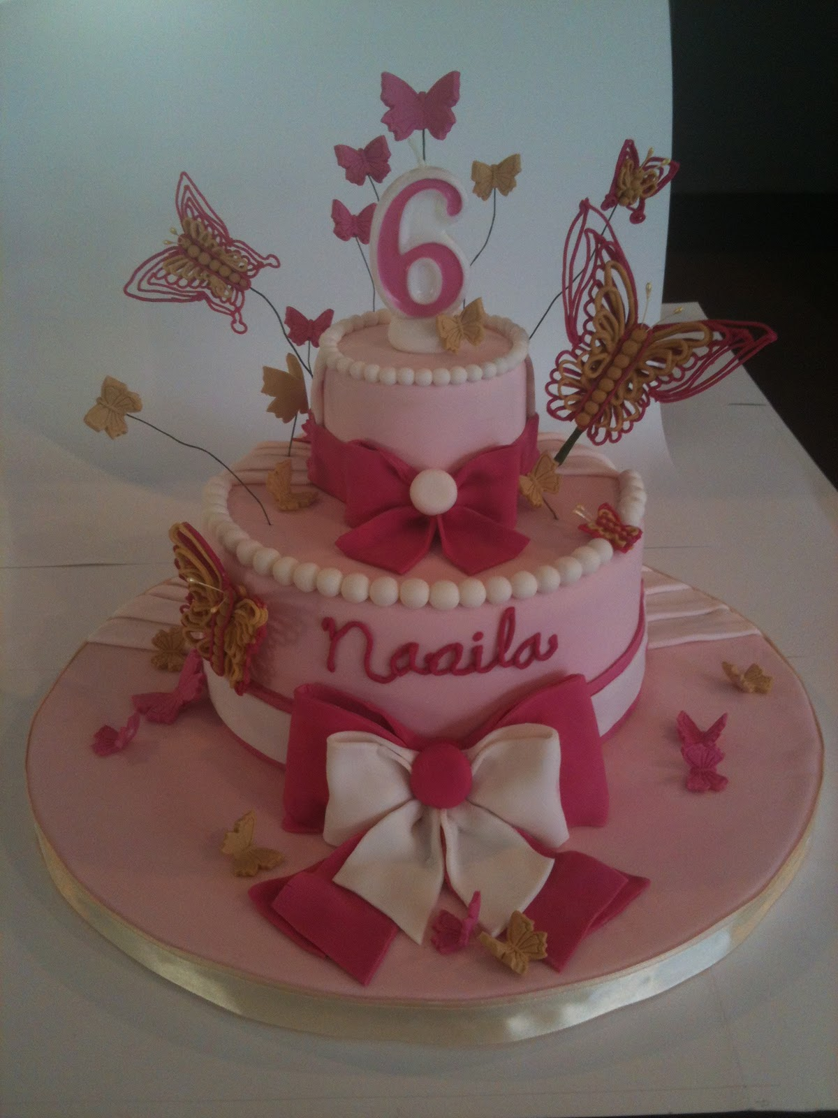 Scrumptious Homemade Butterfly And Bow Birthday Cake