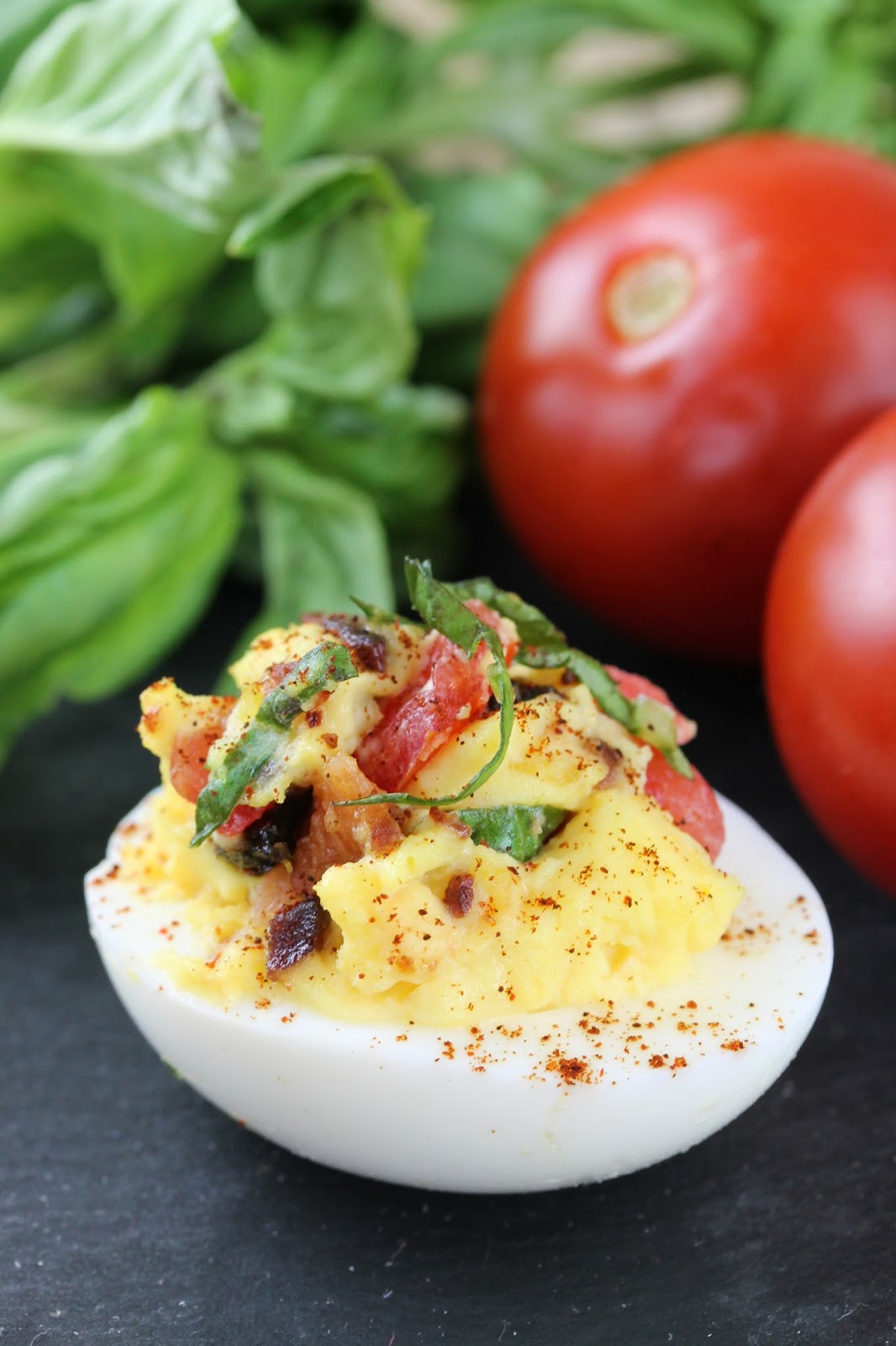 Bacon, Basil (in place of lettuce), and Tomato form this BLT Deviled Egg. This appetizer may be simple, but it packs a punch. The secret is the candied bacon.