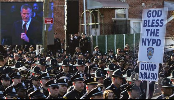 "Composite photo of the police ""turn your back"" protest against NYC mayor de Blasio during the funeral for a officer Rafael Ramos."