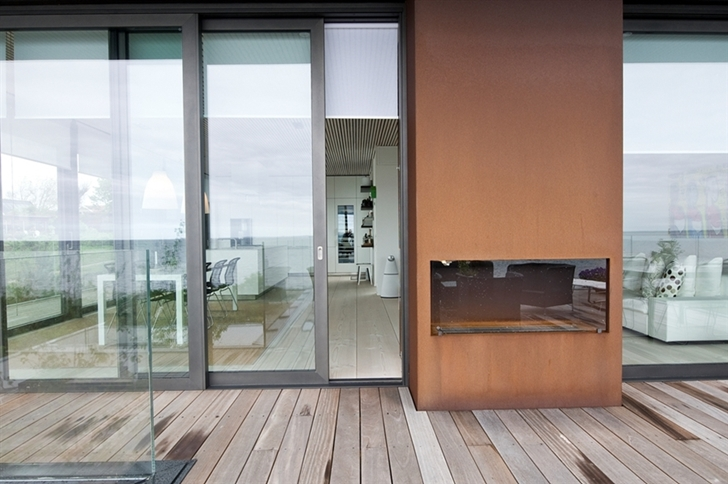 Brown outdoor fireplace in Modern beach house in Sweden
