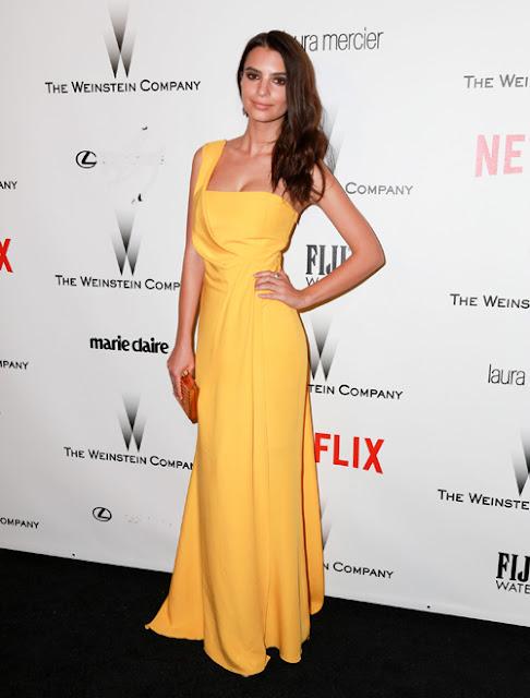 Emily tham dự bữa tiệc sau lễ trao giải Quả Cầu Vàng 2015 trong bộ váy vàng sáng lệch vai.