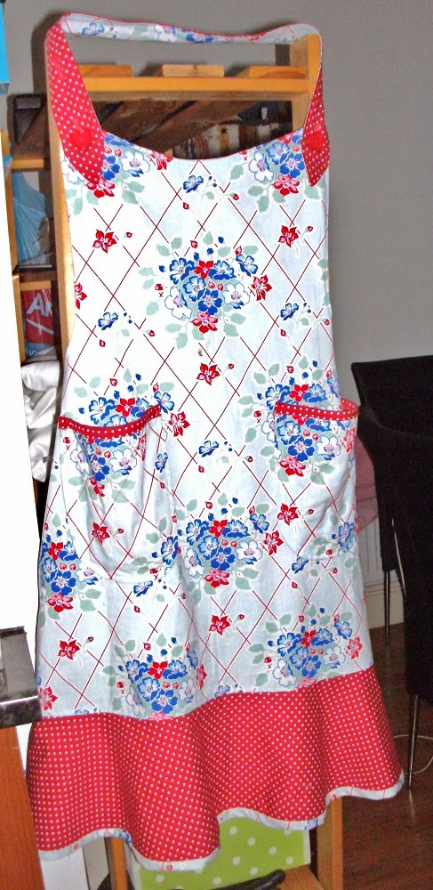 Retro look apron, blue floral with red polka-dot trim