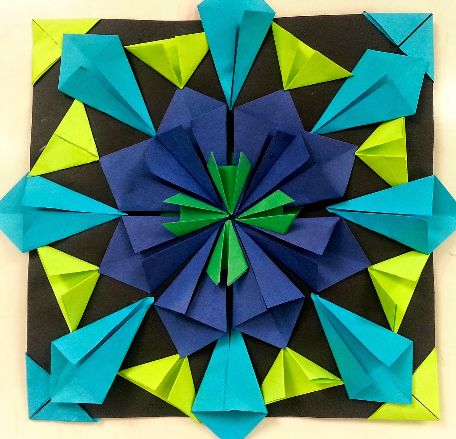 Art with mrs nguyen gram radial paper relief for Paper folding art projects