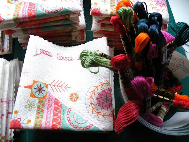 Printed fabric embroidery kits