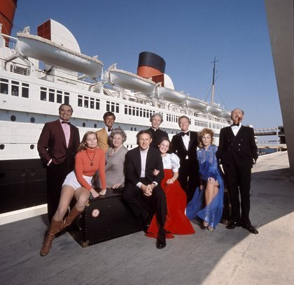 leading actors posed outside the Queen Mary, where exterior filming took place
