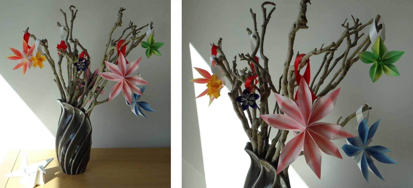 A Vase Full Of Folded Flowers Mostly Folding