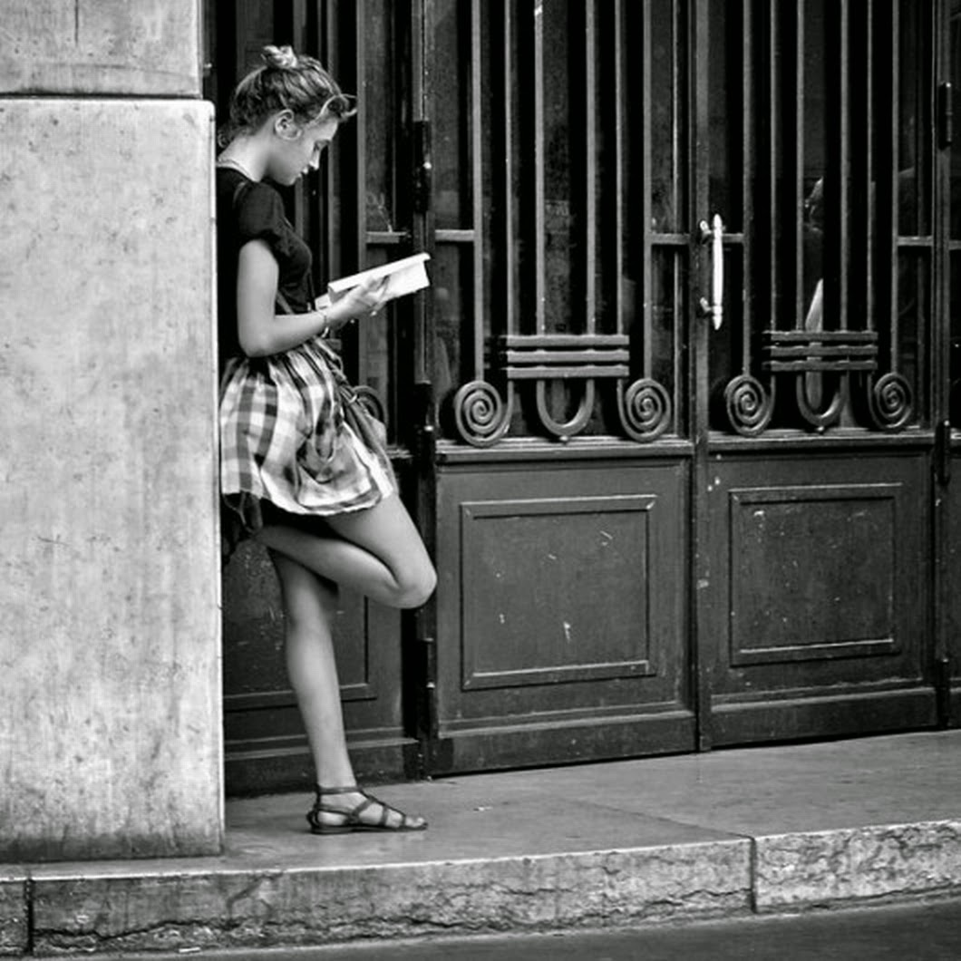 standing woman reading