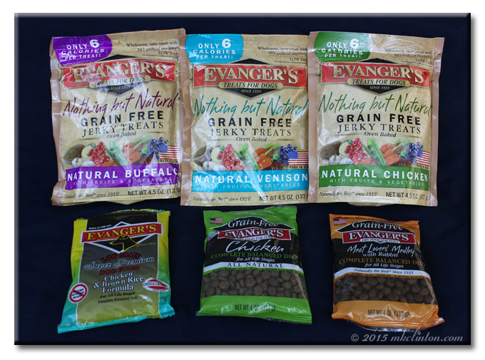 Three bags of Evanger's dog treats and sample food packs