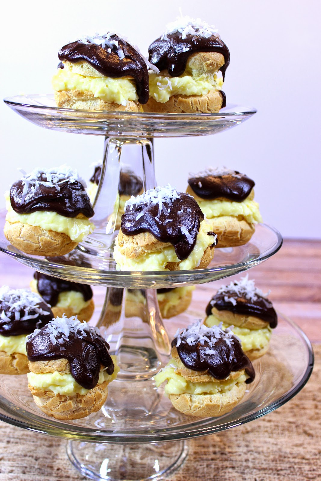 Coconut Cream Puffs are a tasty take on a coconut cream pie, only in cream puff form. - www.kudoskitchenbyrenee.com