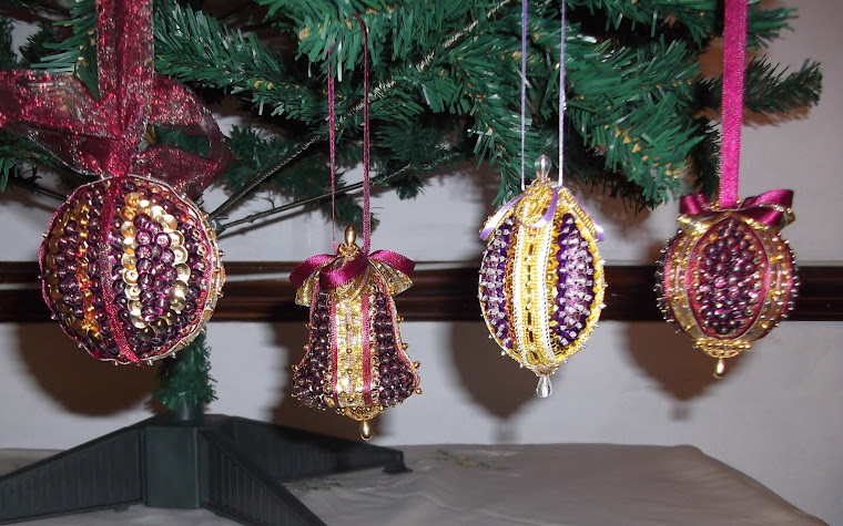I few Christmas baubles I made adapted from a kit