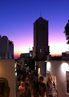 The crowded alleys of Oia at twilight.