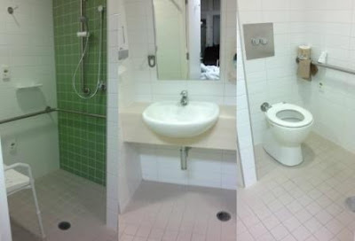 A collage of the accessible three way bathroom viewed from a central doorway.  In the centre is a lowered benchtop and mirror with space underneath the bench to accommodate a chair.  The left hand side of the room is a shower alcove. The right hand side is a toilet alcove.