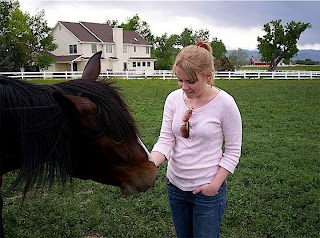 New Faculty Member Dr. Kelly Knight believes in volunteering in the community, which included working with rescued horses in Colorado.