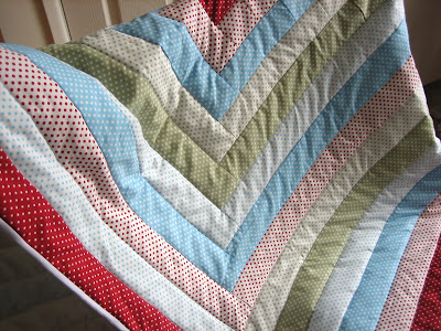 Image of patchwork quilt draped over a chair