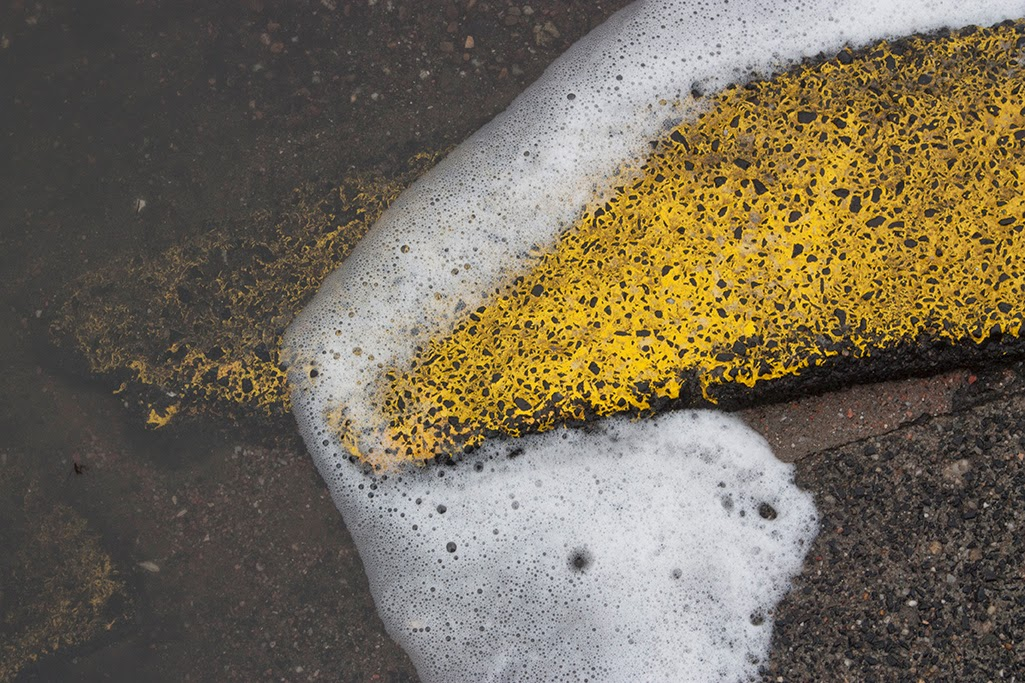 yellow street curb and foam