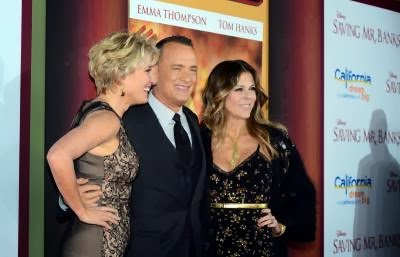 Actor Tom Hanks poses with actress Emma Thompson (L) and his wife Rita Wilson (R)