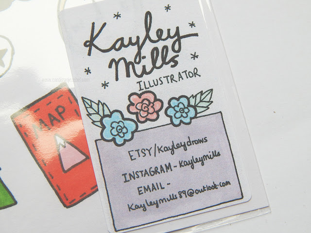 A sticker with all of Kayley Mills's information