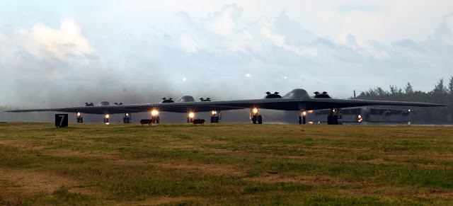 B-2 Spirit bombers taxi down the runway