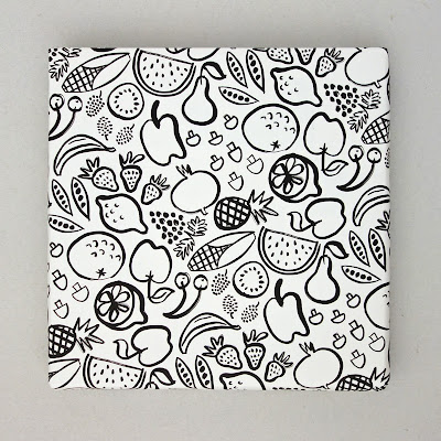 Recycled wrapping paper with monochromatic pattern of fruits, vegetables and a few funghi