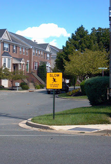 sign that says slow children playing