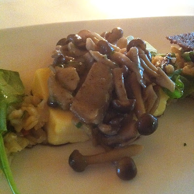 mushroom with a dark sauce that accompanies the cannellini flan