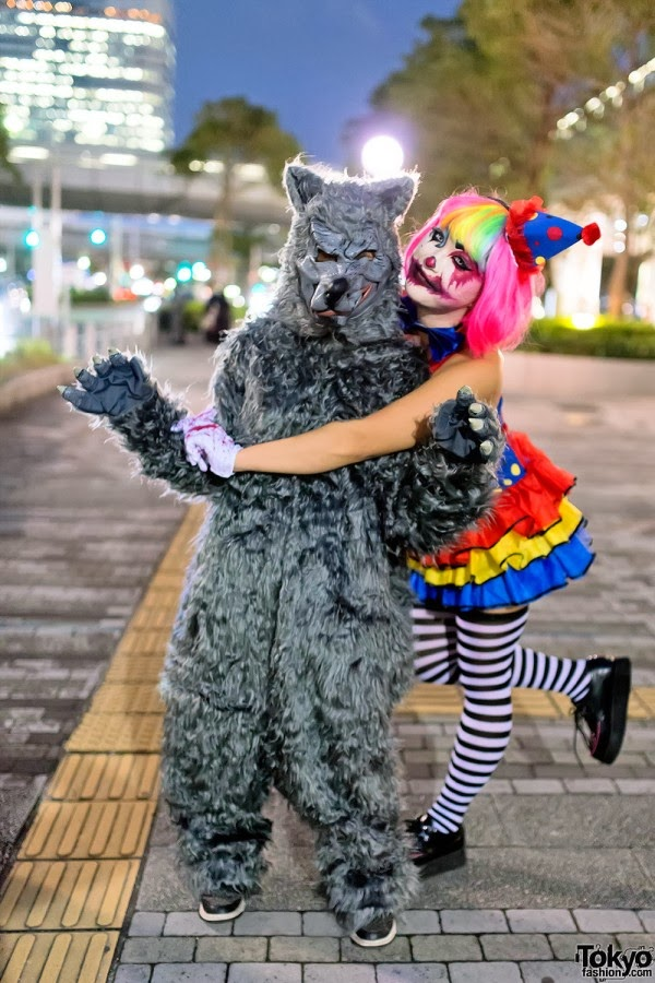Clown jester and wolf costume couple