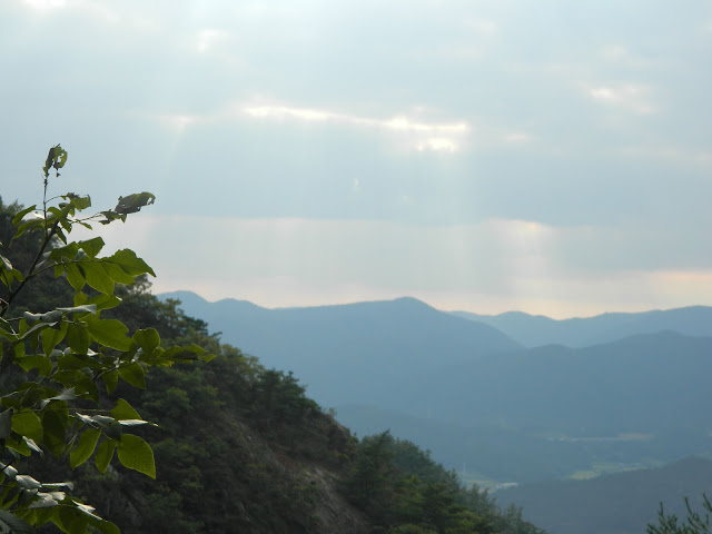 Rays breaking through the clouds, as seen from top of mount Namsan, Gyeongju, Korea