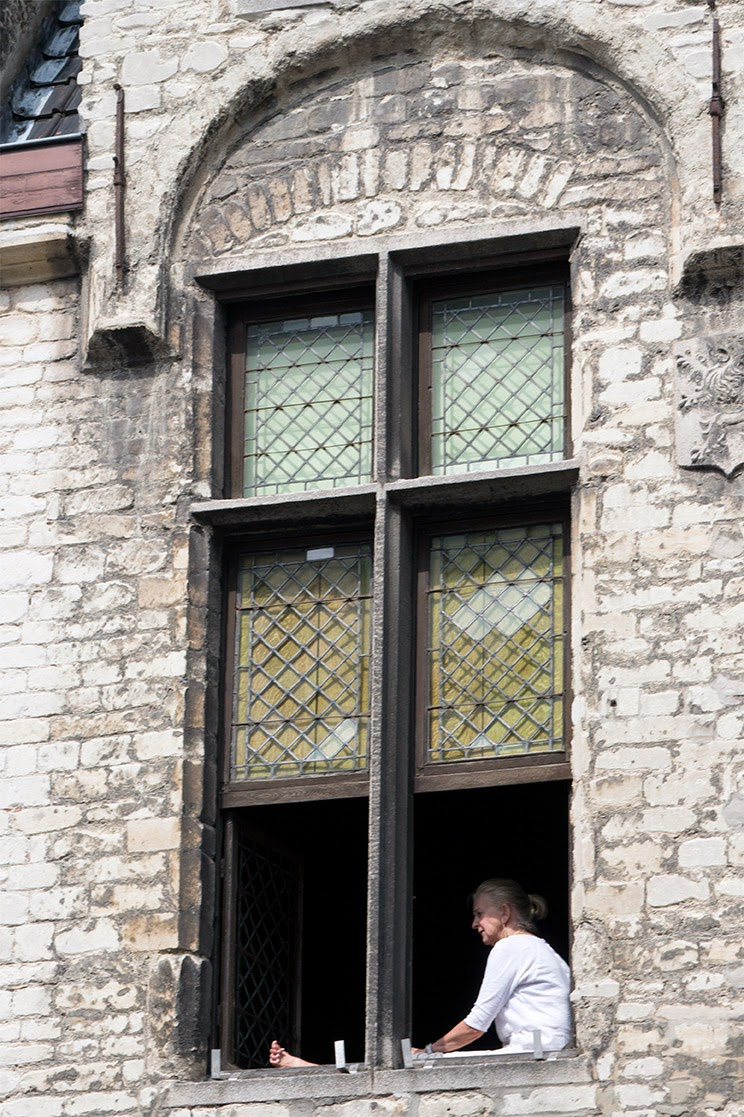 newer window in old romanesque arch