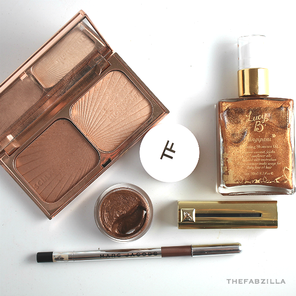 summer 2015 beauty trend, summer 2015 makeup trend, how to wear bronze, billboard music awards 2015 makeup, tom ford cream and powder for eyes naked bronze, lucy b frangipani bronze oil, marc jacobs highliner eye crayon, guerlain automatique, michael kore summer 2015, charlotte tilbury filmstar bronze and glow