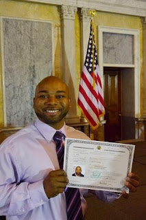 Herbert Proudly Holding his Certificate of Naturalization