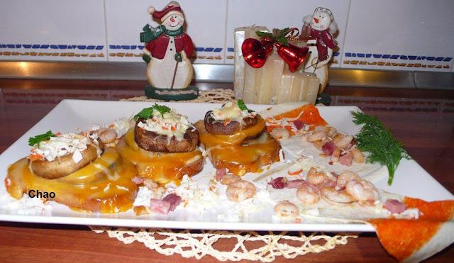Champiñones a los cuatro quesos con finas hierbas,rellenos de jamón y palitos de mar,con guarnición de gambas