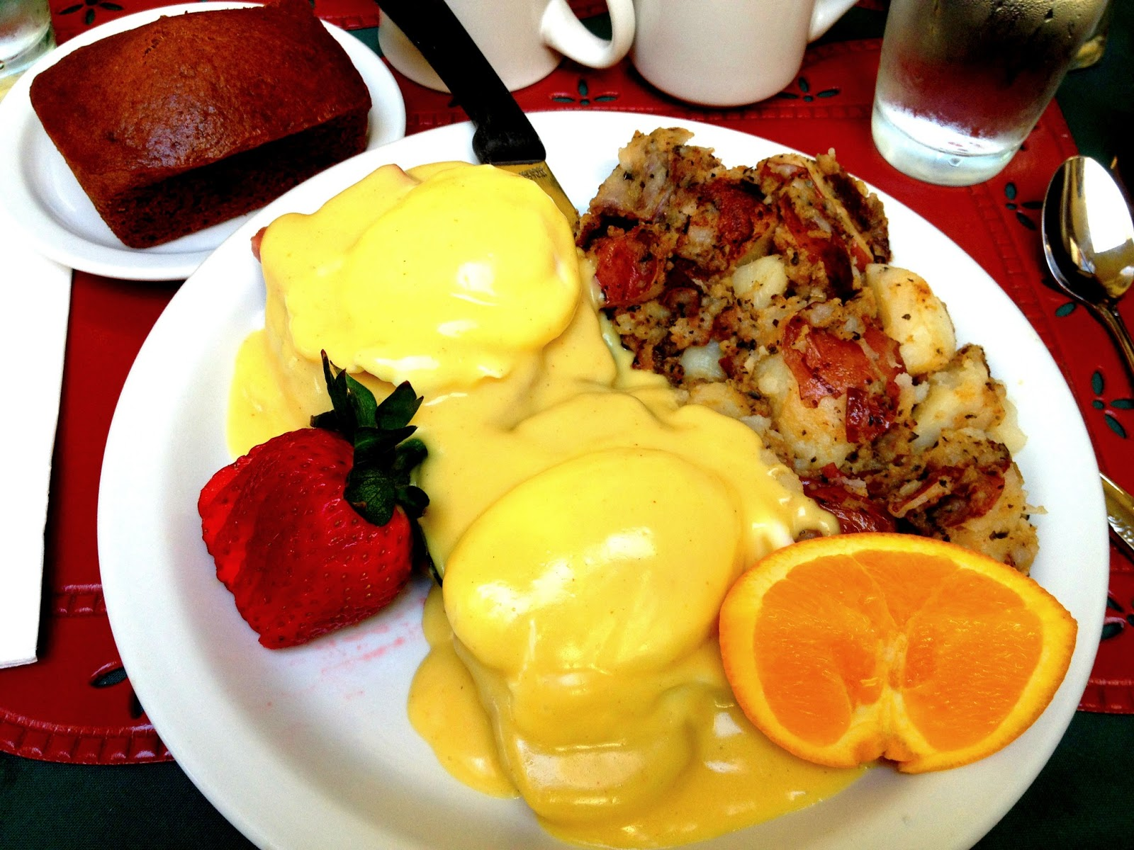 Egg's Benedict Special - with Corned Beef, potatoes, fresh fruit and a pumpkin raisin muffin loaf