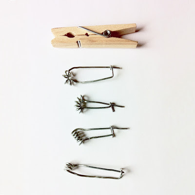 Four wire brooch pins constructed out of clothes peg springs.