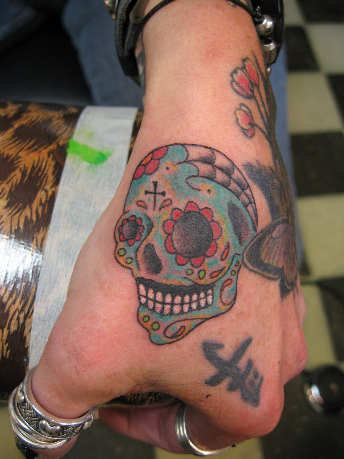 Superior tattoo skull tattoosa little history with photos and sugar skull day of the dead skull by russell fortier lucky 7 tattoo in kings beach north lake tahoe california biocorpaavc Images