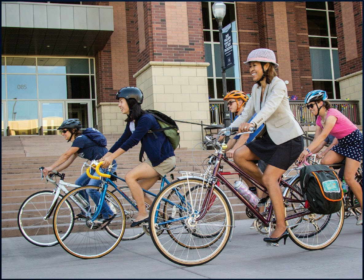 Staff and students bicycling on campus