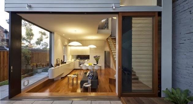 Ruang tamu dan dapur di dalam sebuah ruang terpadu. Fitur furnitur ...