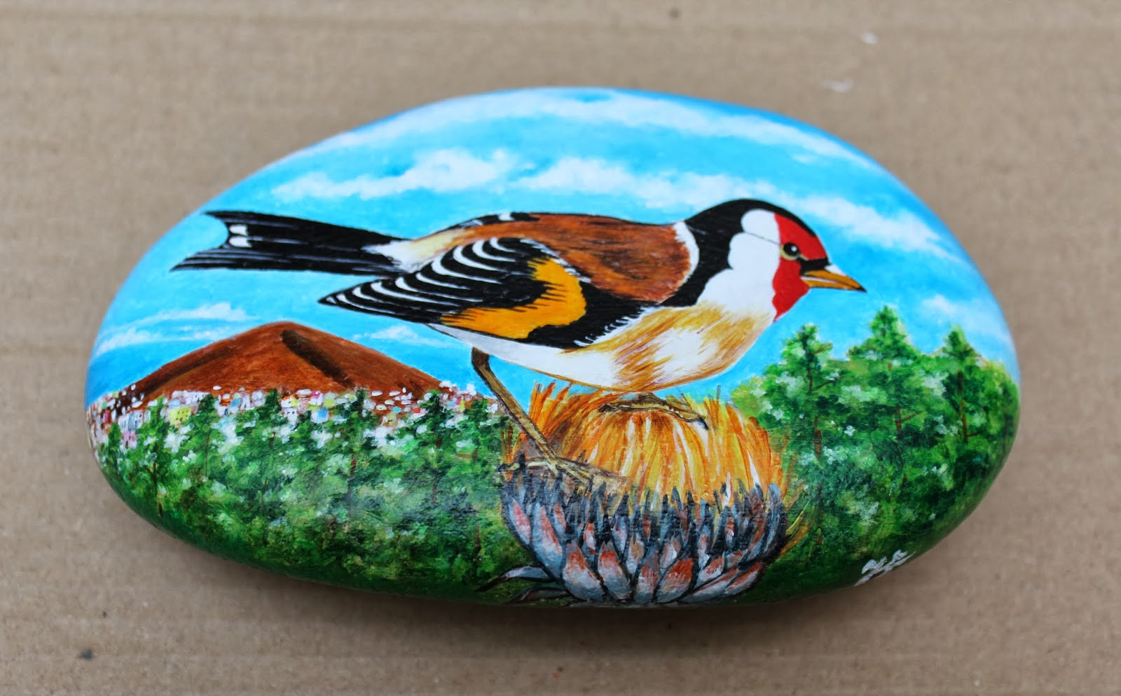 artesano miniaturista pintura y pirograbado piedras pintadas