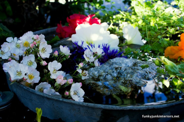 fairy garden pond in garbage can lid