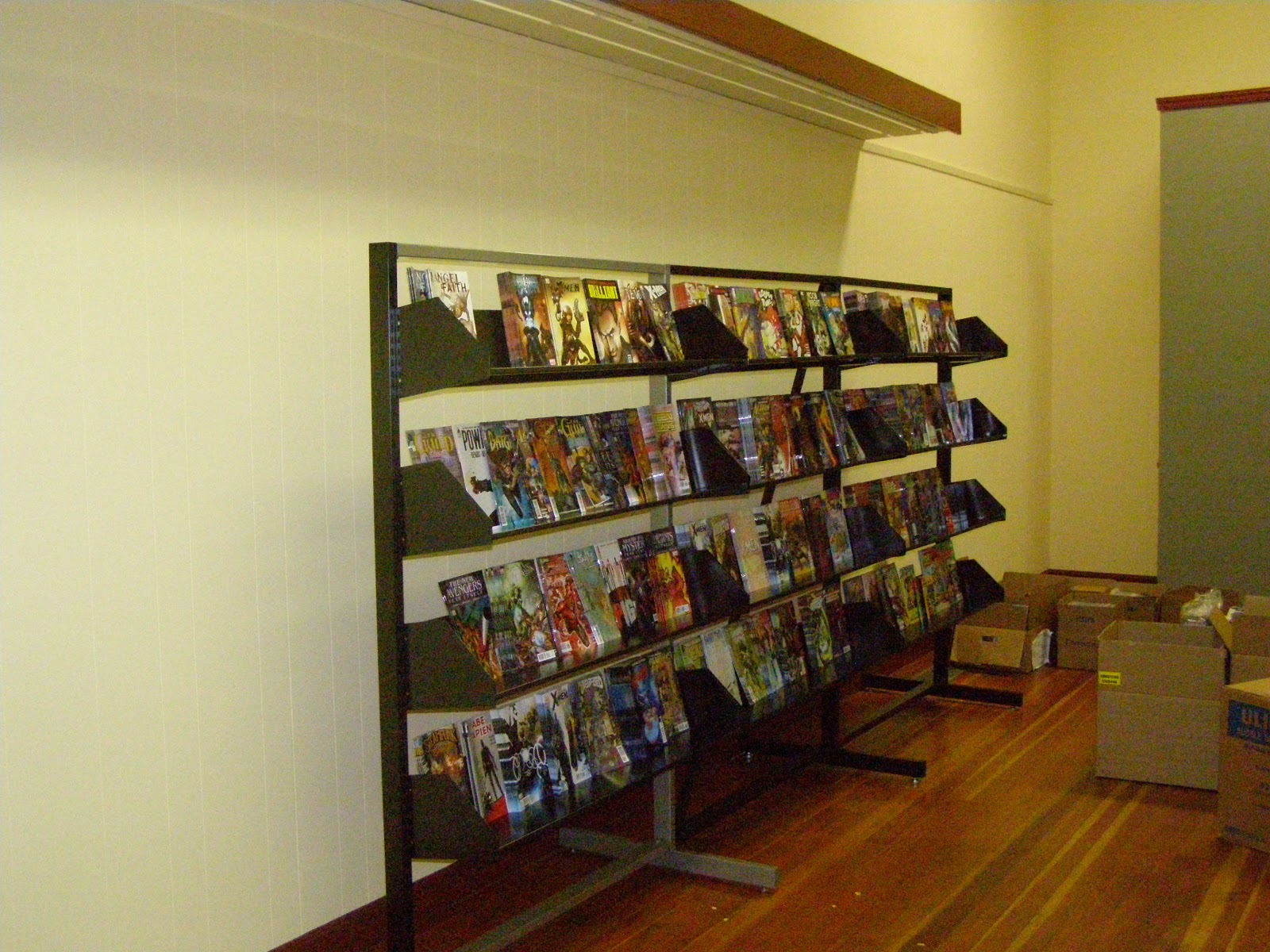 Comic Book Shelving All Things Geeky  Two Cats Comic Book Store Sure We're Open But