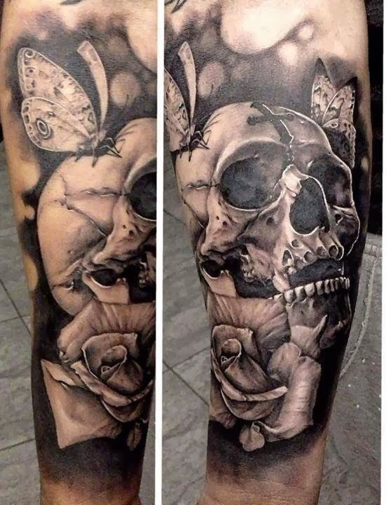 Realistic skull and month tattoo on arm