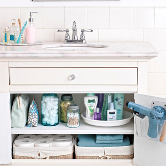 New If you have limited drawer space or no drawers like me in your bathroom I highly remend this blow dryer caddy that goes over your sink door