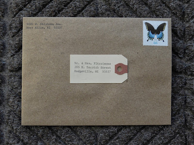 Brown Kraft paper envelope with shipping tag
