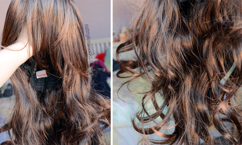 More photos of the brown wavy long wig from Milanoo, held in sunlight.