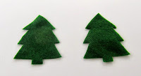 Christmas tree shapes cut out of felt