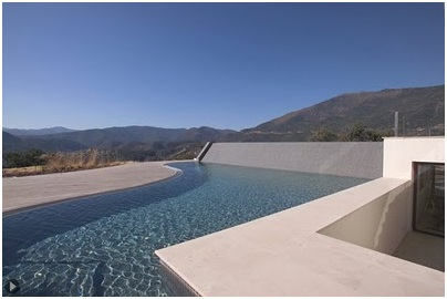 Wooden decks on a poolside. Swimming pool with a beautiful view to countryside