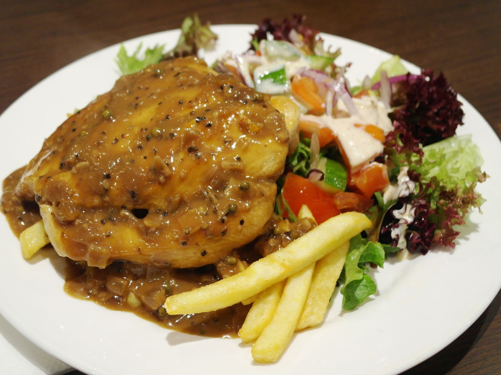 Chiken fillet with pepper sauce served with chips and salad i dont think you can ever go wrong with chicken unless its burnt or something